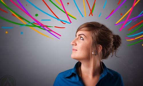 woman-looking-up-in-grey-backdrop-with-multicolored-ribbons.png