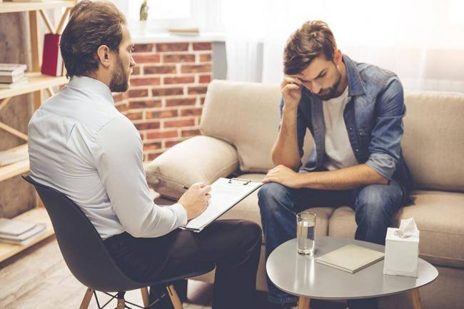 beginningstreatment-should-addiction-counselors-disclose-they-are-in-recovery-article-photo-young-man-talking-to-the-counselor-529084369.jpg